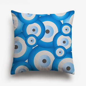 circles of different shades of blue printed on a cushion cover
