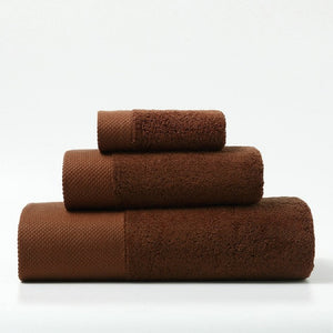 set of 3 luxury towels in different sizes in rust brown colour