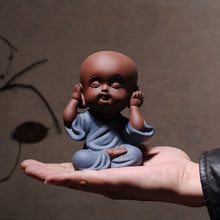 Load image into Gallery viewer, hand holding a baby figurine expressing hear no evil