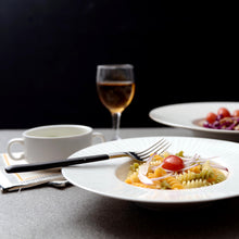 Load image into Gallery viewer, 2 plates of pasta served in a white deep dish plate with a glass of wine