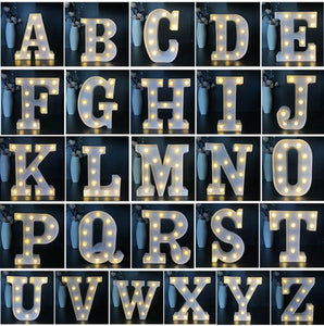 WHITE PLASTIC DECORATIVE LETTERS LIT WITH BULBS