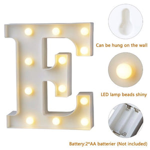 LETTER E LIT WITH BULBS AND SHOWING BATTERY SOURCE