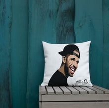 Load image into Gallery viewer, Throw pillow of Drake's face printed placed on a bench against a teal wooden wall