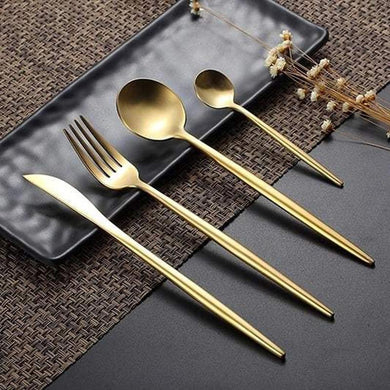 Classy Ains Gold-plated cutlery set with large and small sized spoons, fork and knife resting on a plate