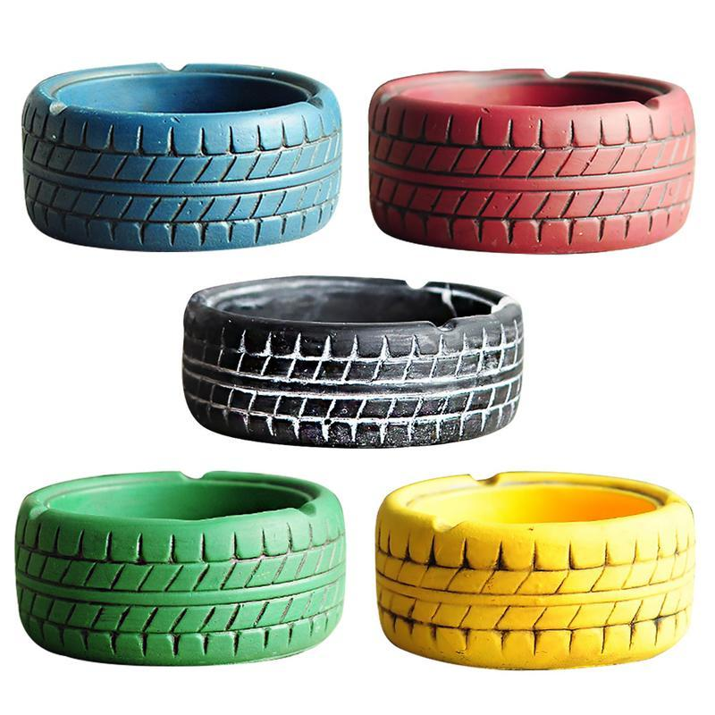 5 tire looking ashtrays in blue, red, black, green and yellow colour