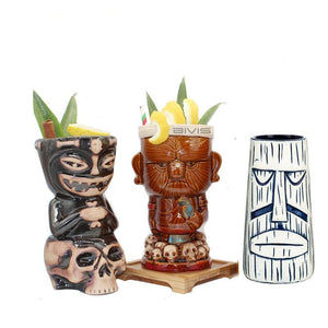 3 different tiki tumblers with cocktails