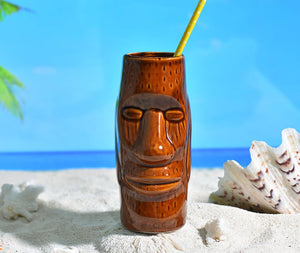 tiki tumbler lying in the sand on the beach