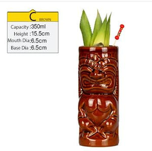 brown ceramic tiki tumbler with cocktail