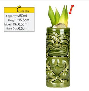 green tiki mug filled with cocktail and some veggies with size specifications