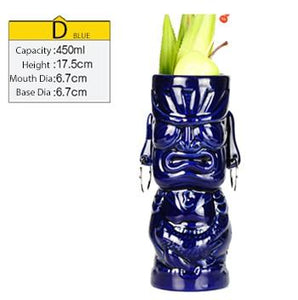 tall blue ceramic tiki mug filled with a cocktail and some veggies and size specifications