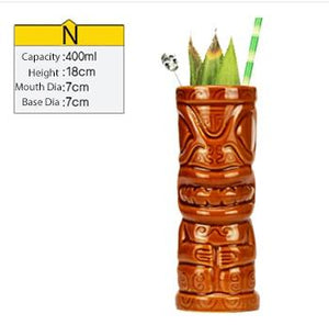 tall brown ceramic tiki mug filled with a cocktail and some veggies and size specifications