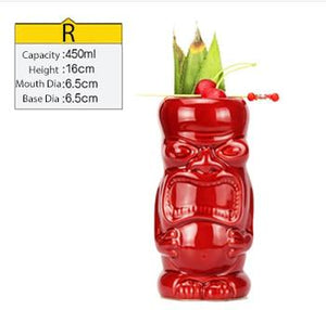 red ceramic tiki mug filled with a cocktail and some veggies and size specifications