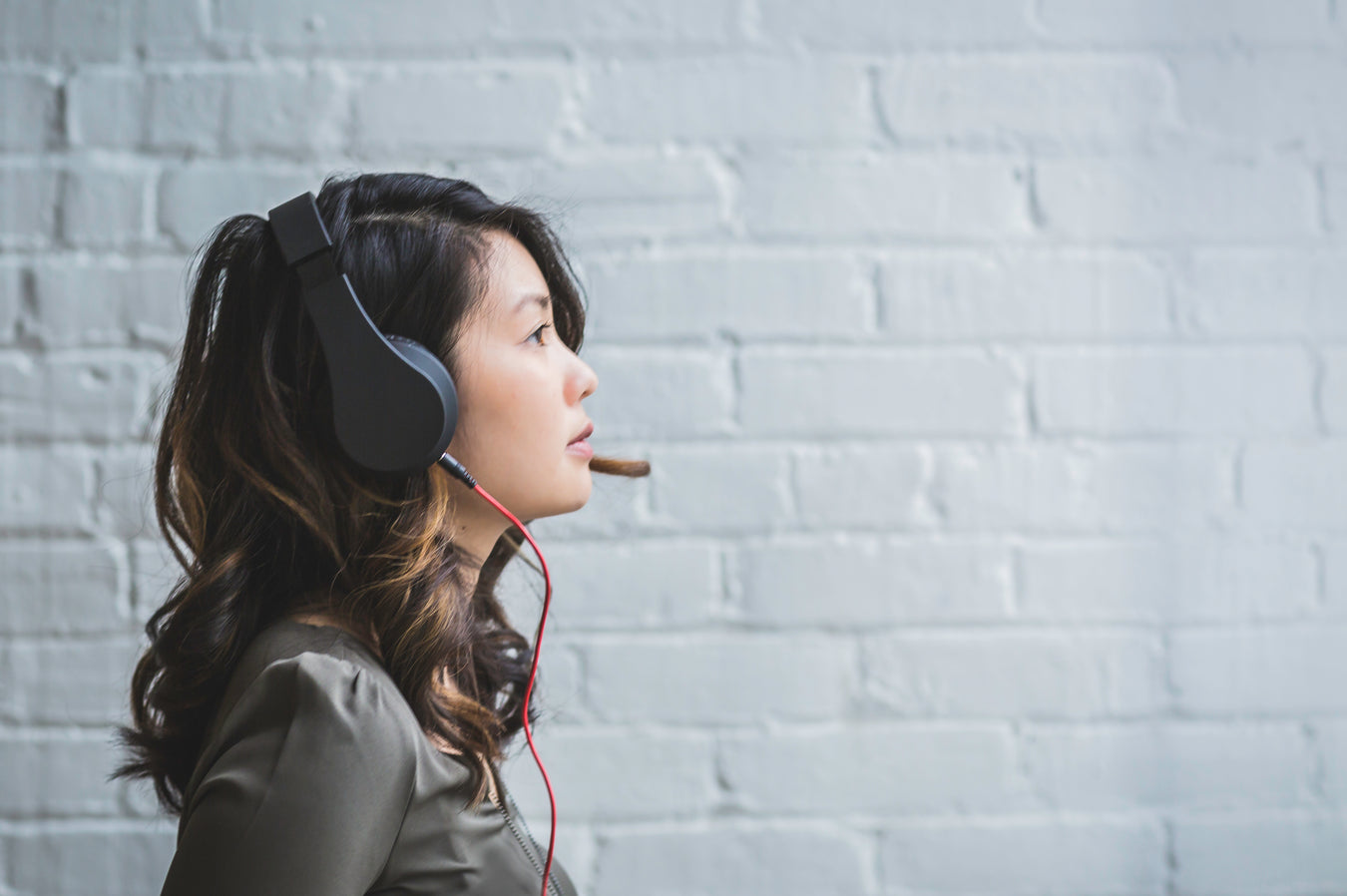 Woman wearing Active Noise Cancelling Headset