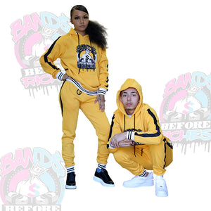 Young man and lady wearing matching unisex Jogger set by bands before riches