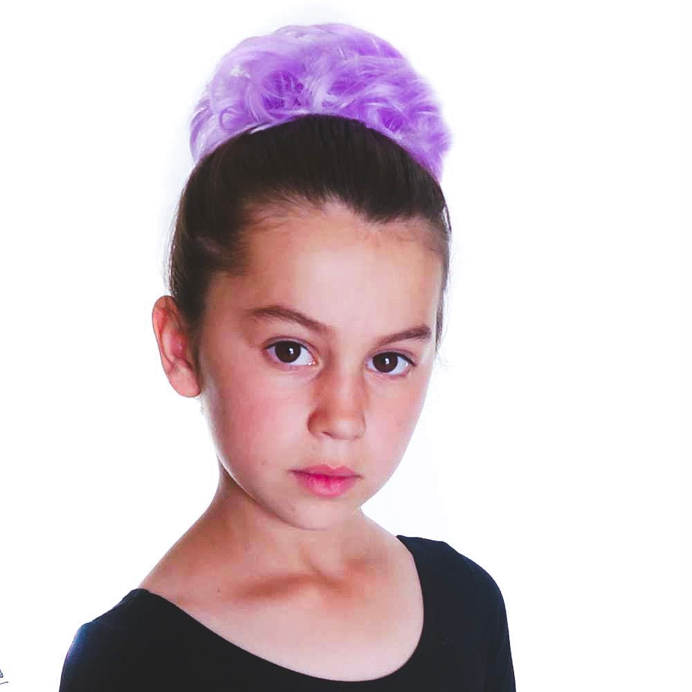 Young kid models a purple hair piece ballerina bun in light purple pastel