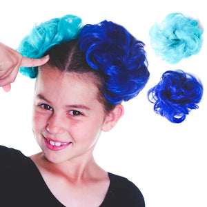 Child models a set of blue and green synthetic hair scrunchies bun extensions