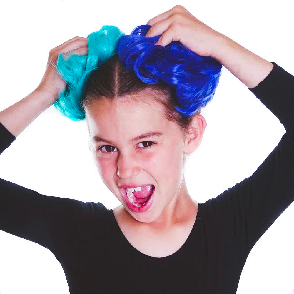 Kids love bright colored hair buns in blue and green space buns