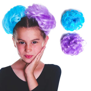 Child models two fluffy hair pieces in lavender purple and aqua blue