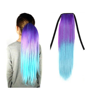 A kid model wears a purple and aqua ombre ponytail hair extension