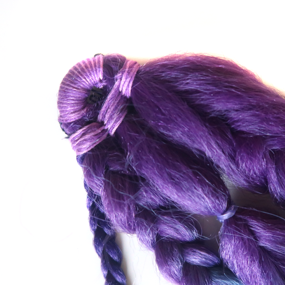 Close-up detail of boho braid clip-in hair extensions