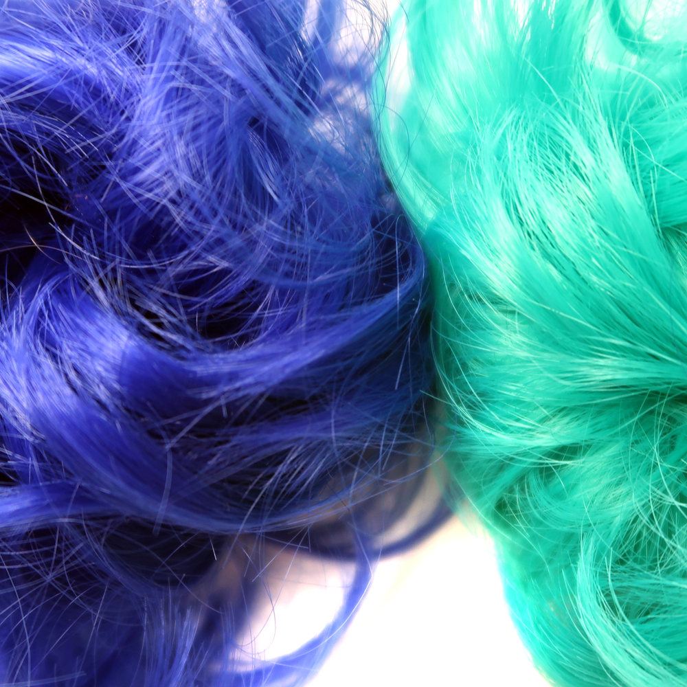 Blue and green hair bun hairpieces close-up of tecture