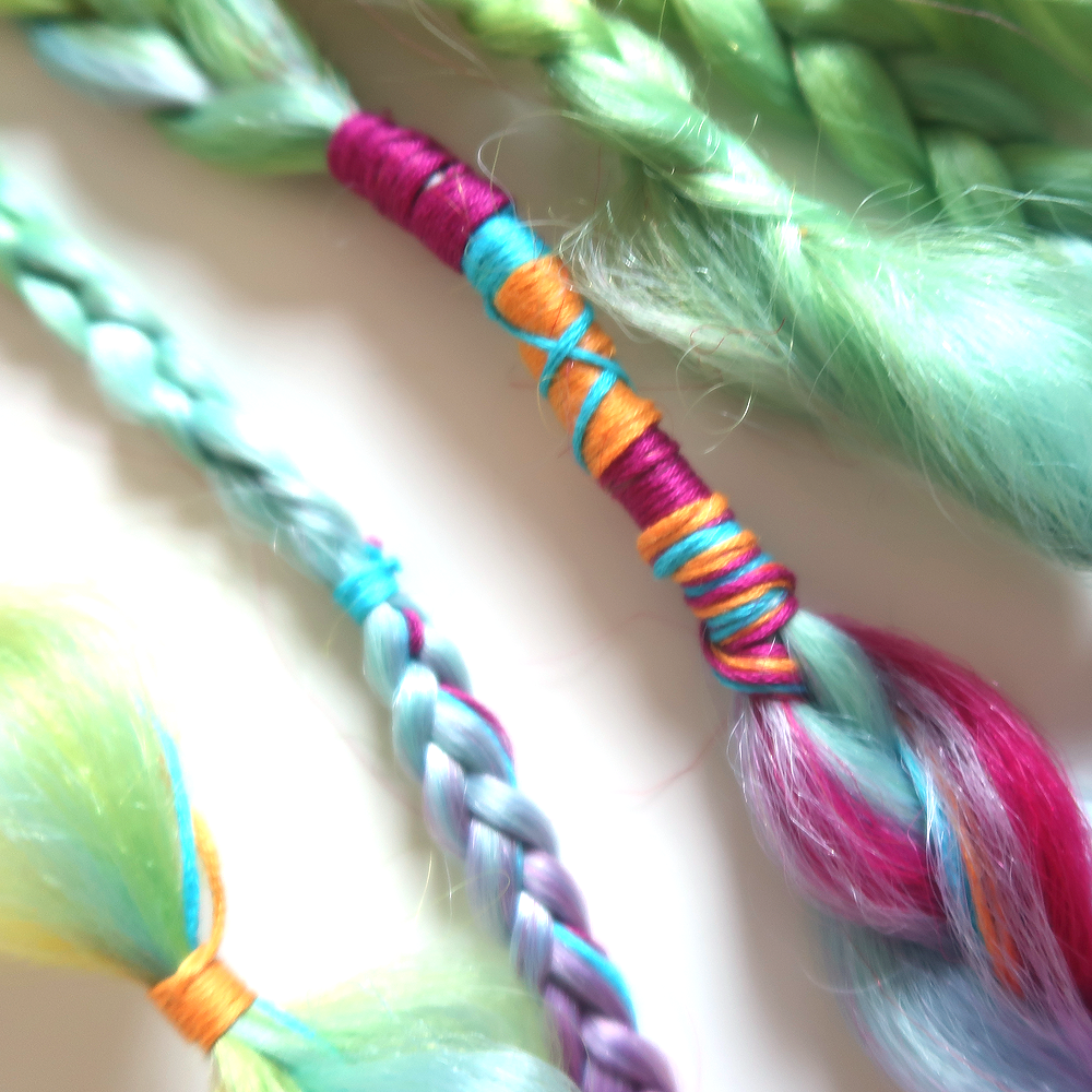 Detail of rainbow boho braids clip-in extensions