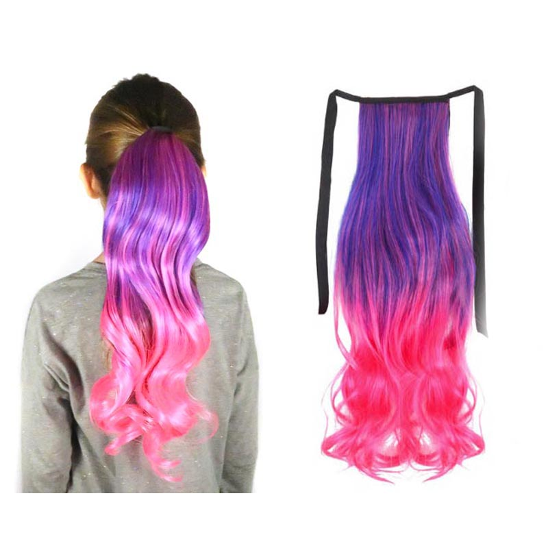 A young model wears a neon pink and purple ombre ponytail hair extension