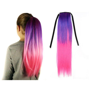 Model wears a lavender and bright pink ombre hair extension over her ponytail