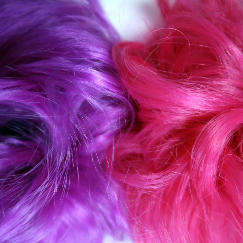 Close up of hair texture in hot pink and purple hair piece chignon bun extension for kids and teens
