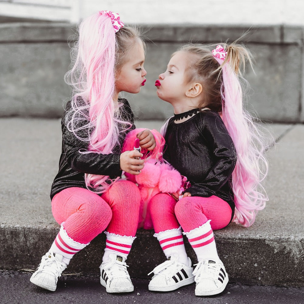 Two little girls in pink ponytails