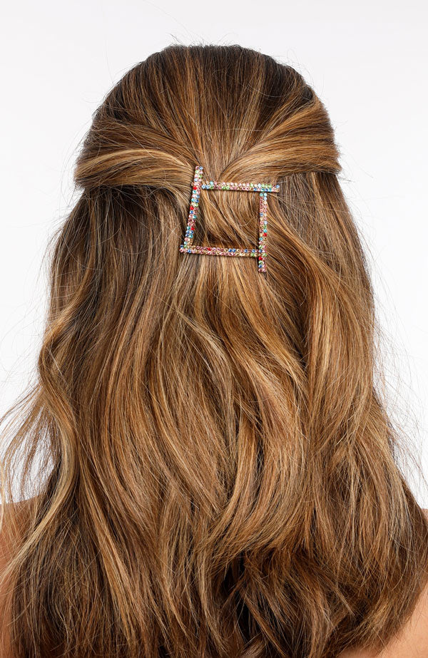 Cute multicolor crystal bobby pins in brown hair