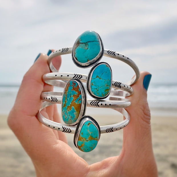 Hand-stamped turquoise cuffs in silver