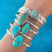 Hand-stamped turquoise cuff in silver