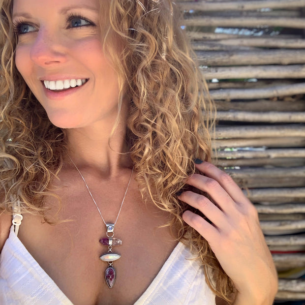Cascading amethyst point, moonstone, and opalized petwood necklace in silver