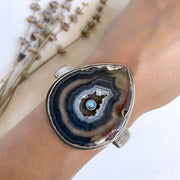 Silver cuff with moonstone inside agate slice