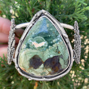 Opalized rhyolite cuff with cedar leaves and pine tree cut-out