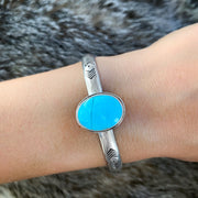 Stamped silver stacking cuff with repaired turquoise