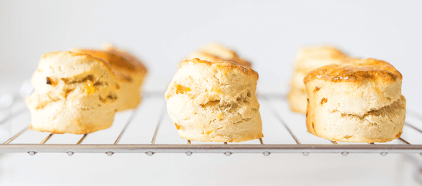 White chocolate scones on a baking rack
