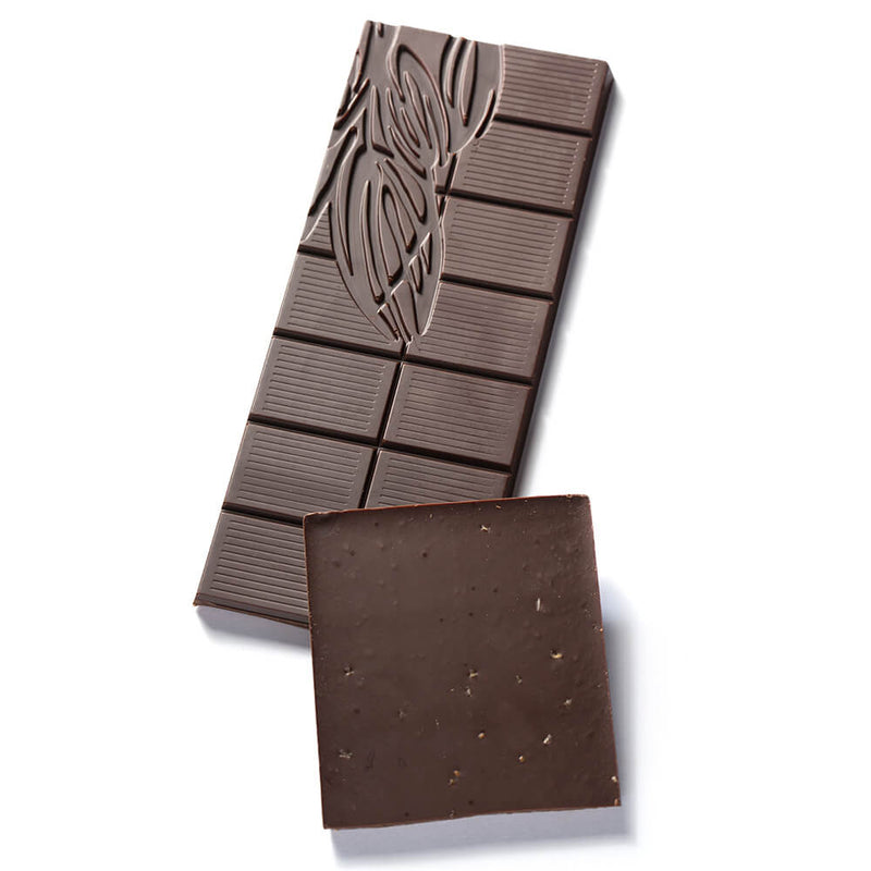 Two pieces of a Dark Chocolate Oregano Fusion Bar