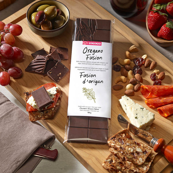 Dark Chocolate Oregano Fusion Bar on a charcuterie board