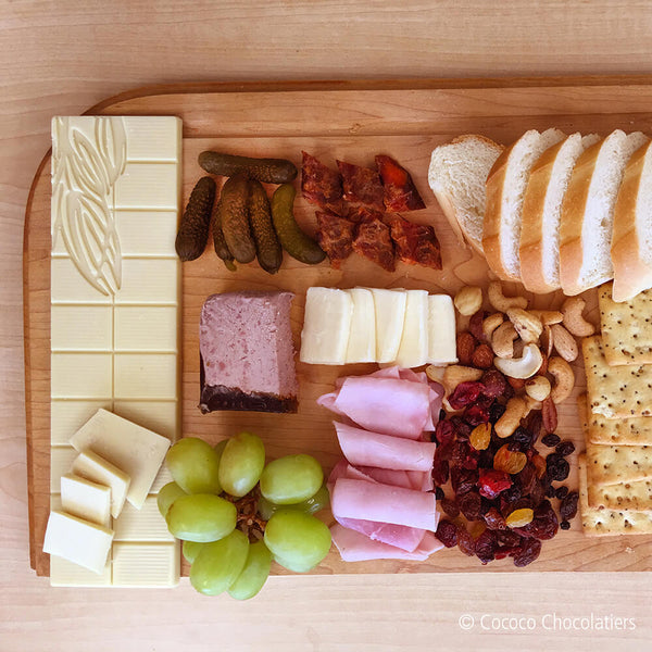 Full charcuterie board with a bar of Dill Fusion White Chocolate