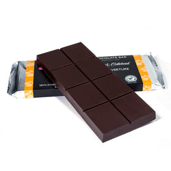 Dark chocolate baking bar propped up on to a packaged baking bar