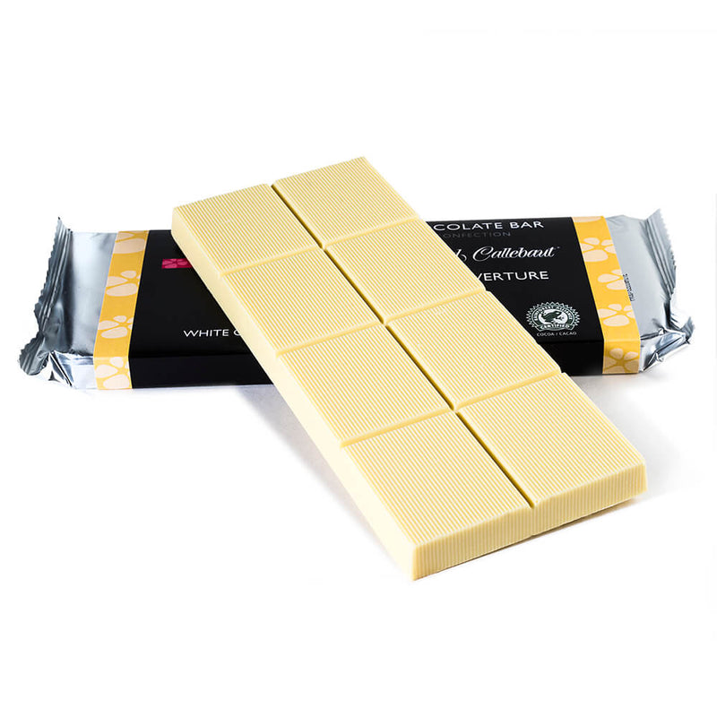 White chocolate baking bar propped up on to a packaged baking bar