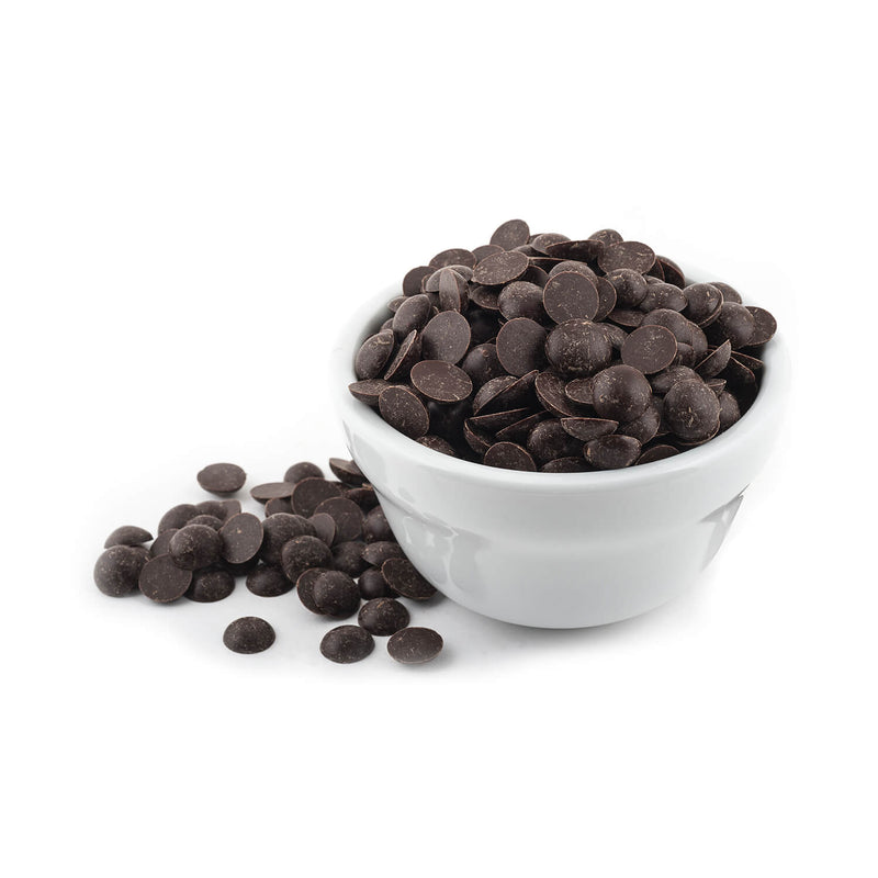 A white bowl full of semi-sweet chocolate chips