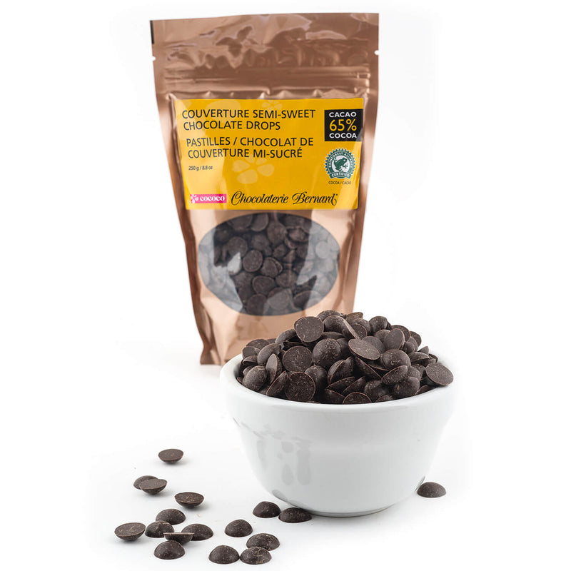 250g gusseted bag of chocolate chips with a white bowlful in foreground