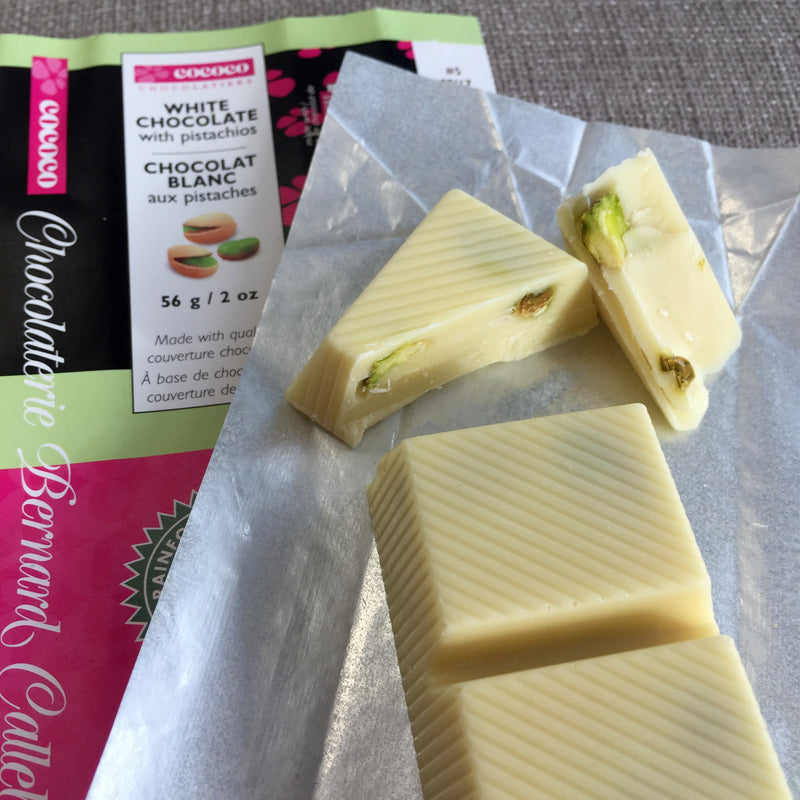 Closeup of an opened bar package of the white chocolate with pistachios