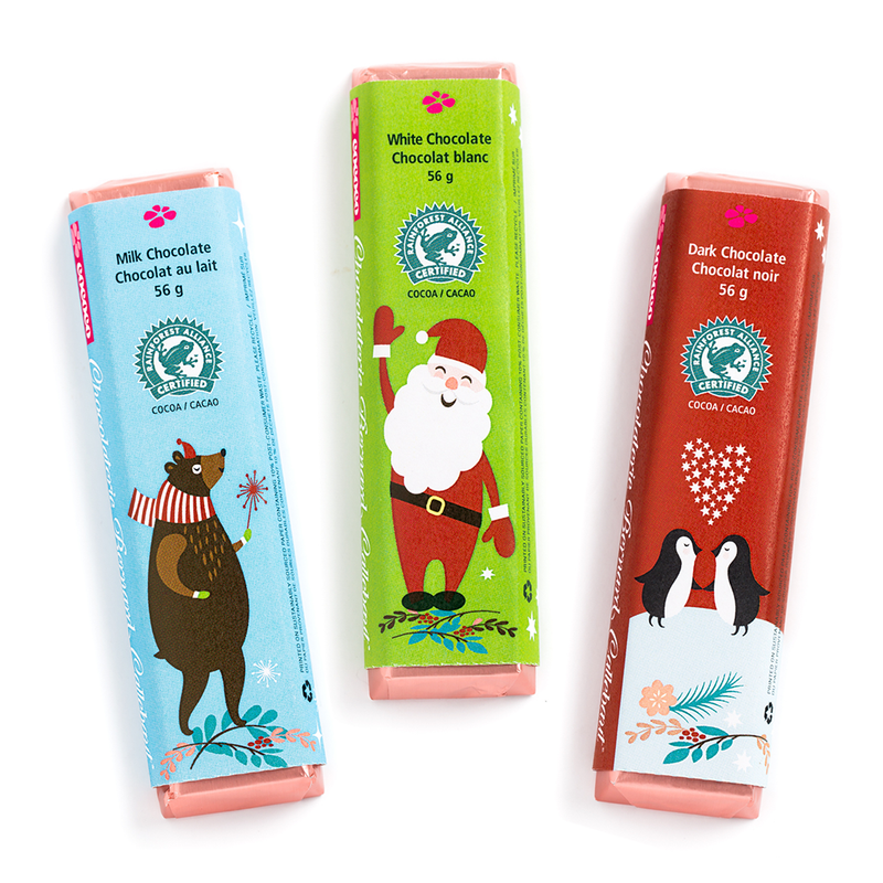 The chocolate bars, dark, milk and white chocolate, in Christmas season packaging.