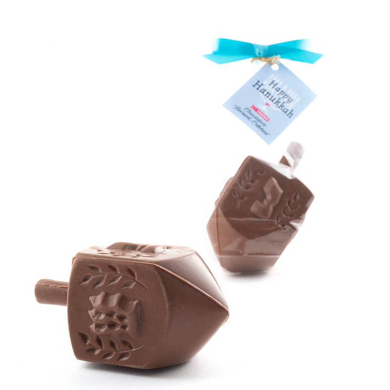 Two milk chocolate driedls, one packaged in cello with blue ribbon and tag