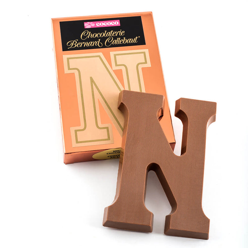 Milk chocolate letter N on top of it's Chocolaterie Bernard Callebaut®  box