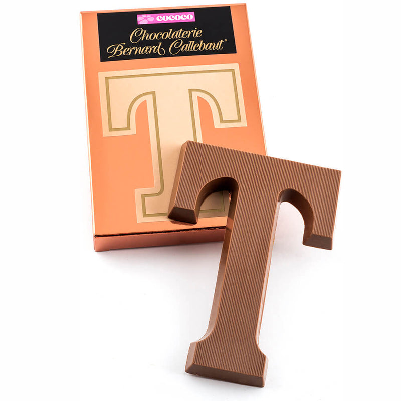 Milk chocolate letter T on top of it's Chocolaterie Bernard Callebaut®  box